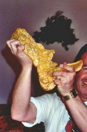Man lifting Boot of Cortez the biggest gold nugget
